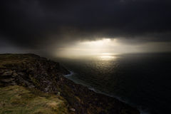 Every Cloud. Stormy day in Donegal Bay but a small sliver of sunshine has made it through. Photo taken near the Slieve Liag Royalty Free Stock Photo