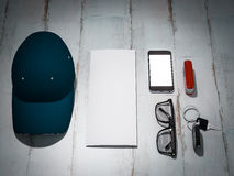 Every day carry man items collection: glasses, cap, knife. Royalty Free Stock Photo