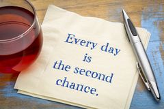 Every day is the second chance. Handwriting on a napkin royalty free stock image