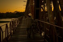 Every day thousands of people cross the bridge over San Francisco river, between Pirapora and Buritizeiro, in Minas Gerais, Brazil stock photography