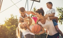 Every moment spent together is absolute bliss. Family on basketball court. Close up royalty free stock photos