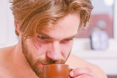 Every morning with his coffee. Man bearded handsome macho hold cup of coffee. Best time to have your cup of coffee. Guy royalty free stock photography