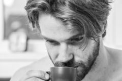 Every morning with his coffee. Man bearded handsome macho hold cup of coffee. Best time to have your cup of coffee. Guy stock image