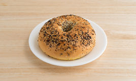 Every seasoning bagel on a white plate Stock Photo