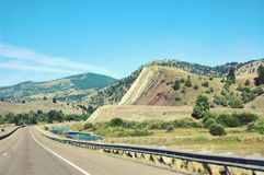 Montana state usa typical road river mountains stock photo