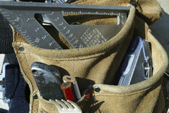 Every Tool for the Job. A leather tool belt filled with tools Royalty Free Stock Image