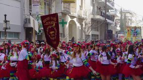 Carnival parade participants marching in costumes in Xanthi, Greece. stock footage