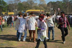 Everybody are enjoying Holi, the color festival of India. stock images
