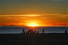 A Sunday afternoon sunset party on the California coast. Everybody loves the sunset 365 days a year purely for the colors of the sky as the sun passes the royalty free stock photography