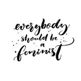 Everybody should be feminist. Feminism quote, brush calligraphy with ink drops. Stock Image