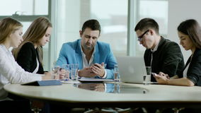 Everybody using phones on meeting. Business and technology. everybody using phones on meeting stock footage