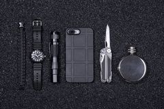 Free Everyday Carry EDC Military Items For Men- Multi Tool, Lighter, Phone, Tactical Watch, Survival Bracelet,flashlight And Flask. Stock Photos - 151521503