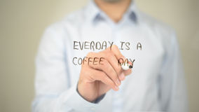Everyday is a Coffee day, Man writing on transparent screen Royalty Free Stock Photos
