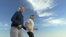 Everyday jogging keeps them fit stock video