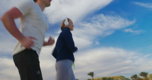 Everyday jogging with music stock video footage