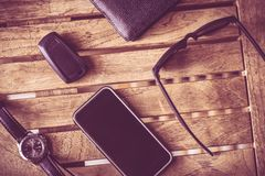 Everyday Man Tools. Smartphone, Car Keys, Glasses and Wallet on the Table Royalty Free Stock Images