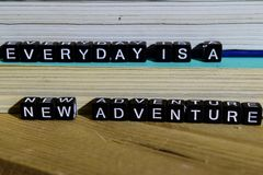 Everyday is a new adventure on wooden blocks. Motivation and inspiration concept. Cross processed image royalty free stock image