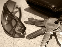 Everyday Objects. Glasses, keys and wallet on bench Stock Images