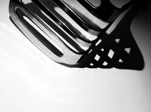 Everyday. Shedding a new sense of light on everyday utensils. Here I have photographed a food masher, by placing the item on its side and moving an iPhone torch Stock Photography