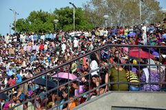 Everyday show on the Indian-Pakistan Wagah border in Amritsar. AMRITSAR, INDIA - APRIL 10,2013 - Crowds of people at the Wagah border in Amritsar, India stock photography