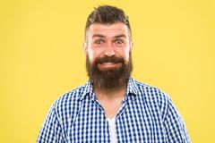 Because everyone deserves to smile. Happy man on yellow background. Bearded man smiling. Caucasian man with mustache and royalty free stock photo