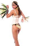 Everyone follow my steps. Pretty samba dancer woman looking back over white Stock Images