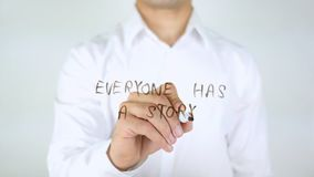 Everyone Has a Story, Man Writing on Glass stock photo