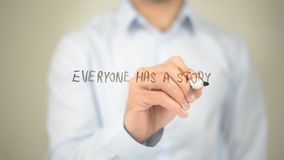 Everyone Has a Story, Man writing on transparent screen royalty free stock photo
