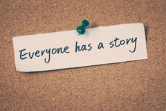 Everyone has a story. Note pin on the bulletin board stock image