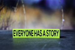 Everyone Has A Story on the sticky notes with bokeh background royalty free stock photos