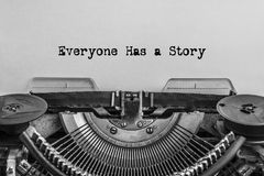 Everyone has a story, typed words on a vintage typewriter. royalty free stock images