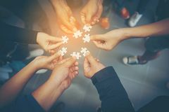 Everyone is an important jigsaw at work. Think of teamwork. Of successful businesspeople And teamwork quality stock photography