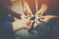 Everyone is an important jigsaw at work. royalty free stock photo