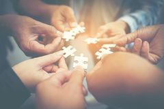 Everyone is an important jigsaw at work. stock photo