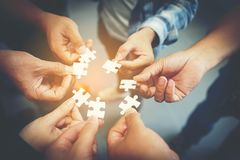 Everyone is an important jigsaw at work. stock photography