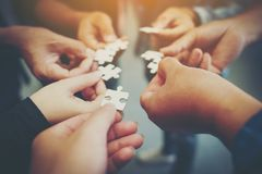 Everyone is an important jigsaw at work. Think of teamwork. Of successful businesspeople And teamwork quality royalty free stock image