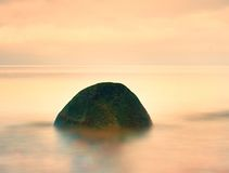 Everyone loves romantic atmosphere of sea. Peaceful sea level, stones in  water Stock Photos