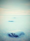 Everyone loves romantic atmosphere of sea. Peaceful sea level, stones in  water Royalty Free Stock Images