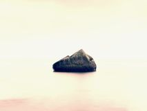 Everyone loves romantic atmosphere of sea. Peaceful sea level, stones in  water Stock Image