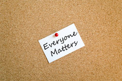 Everyone matters concept. Sticky Note On Cork Board Background everyone matters concept stock photo
