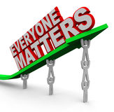 Everyone Matters Teamwork People Lifting Arrow. The words Everyone Matters lifted on an arrow carried by team members to help the group succeed Royalty Free Stock Images
