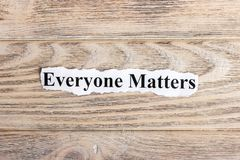 Everyone Matters text on paper. Word Everyone Matters on torn paper. Concept Image.  stock image