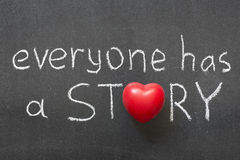 Everyone story. Everyone has a story phrase handwritten on chalkboard with heart symbol instead of O royalty free stock photo