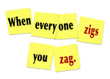 When Everyone Zigs You Zag Sticky Notes Saying Quote. The words or saying When Everyone Zigs You Zag on yellow sticky notes to illustrate being unique, special Royalty Free Stock Images