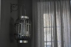 Everything appeared gray. Gray lamp, cream curtain and dim room. Everything appeared gray stock images