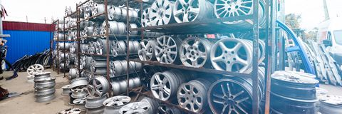Auto parts market. Car wheels are on the ground. Everything for car repairs. Stacks of car rims stock photography