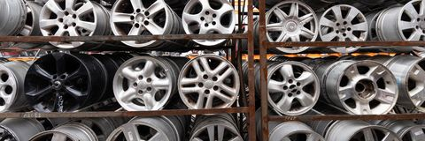 Auto parts market. Car wheels are on the ground. Everything for car repairs. Stacks of car rims royalty free stock photos