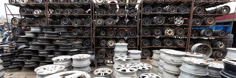 Auto parts market. Car wheels are on the ground. Everything for car repairs. Stacks of car rims stock image