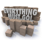Everything Must Go Boxes Overstock Inventory Store Closing Sale. Everything Must Go words in 3d letters surrounded by cardboard boxes in a store warehouse to Royalty Free Stock Photos