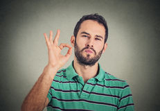 Everything is OK! Happy man gesturing OK sign Stock Photo